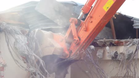 demolice : Building demolition, excavator and twisted rebars