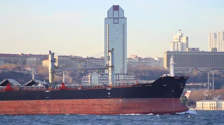 felhőkarcoló : Bulk carrier ship sails along Bosporus Sea. Close up of large freighter ship. Stock mozgókép