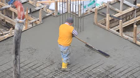 cement floor : Concreting and smoothing slab on the building. Pouring concrete mix from cement mixer on concreting formwork and finished leveling the slab. A laborer working on concreting slab of steel reinforced concrete Stock Footage