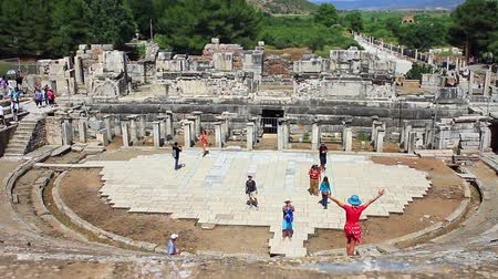 seljuk : EPHESUS, TURKEY - Jun 15, 2014: Most magnificent structure in the ancient city of Ephesus. The Great Theatre is located on the slope of Panay Hill, opposite the Harbor Street, and easily seen when entering from the south entrance to Ephesus. Stage Theater Stock Footage