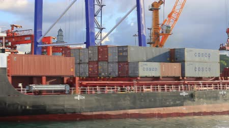 navios : ISTANBUL - SEP 23, 2013: Cargo container ship CONTSHIP ECO Flag: Malta in Haydarpasa sea ports. 124 mt long, 21 mt width vessel, launched into the sea in 2008 and has a deadweight of 9,907 tons. Crew working on the open deck of the container ship Vídeos