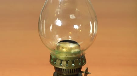 lampa naftowa : Traditional retro alike safety oil lamp. Storm lantern. Tilt from bottom to top
