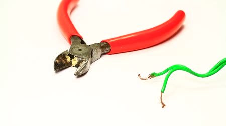 wire stripper : Electrician cutting the cable end using a stripper cutter. Isolated on white. Cutting the cable end