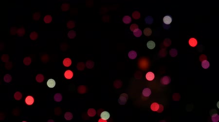 Bokeh and blur of fireworks exploding at night in the sky. Colourful fireworks defocus. Defocused abstract lights. Firework lights in the night sky. Fireworks background. Dostupné videozáznamy