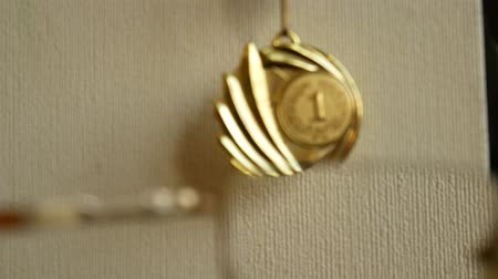 desfocado : Using of glasses improves image of golden medal from blurred to clear, optometry. Bad eyesight. Unfocused vision becomes clear. Golden medal hanging on the wall