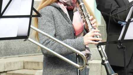 A band of musicians performing in the streets. Focus on clarinet player