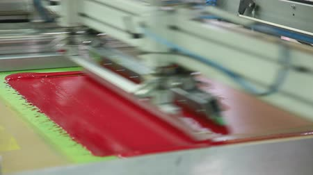 printings : Screen printing machine working, printing magenta