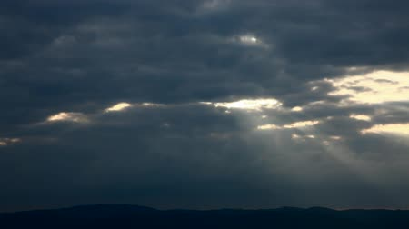 evening sun : Time lapse recording of sun rays fading away between clouds Stock Footage