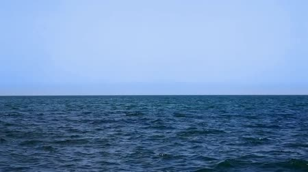 horizont : Calm sea water surface and horizon (Black Sea) Stock mozgókép