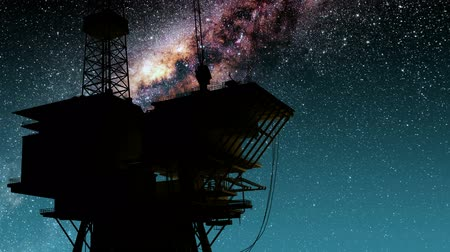 oliwa : Silhouette of oil rig and Milky Way stars at night. Wideo