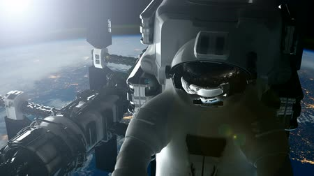 astronauta : ISS. Astronaut and International Space Station Orbiting Earth.