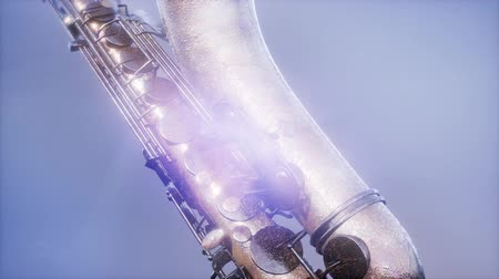 valf : Golden Tenor Saxophone on blue background with light Stok Video