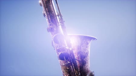 flet : Golden Tenor Saxophone on blue background with light Wideo