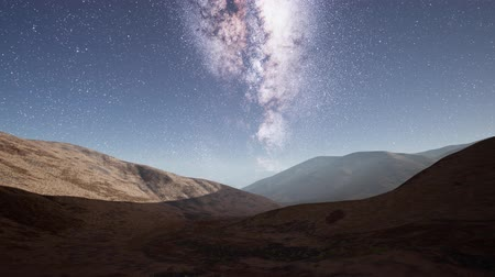 yolları : Milky Way stars above desert mountains