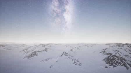 antarktyda : aerial view of Milky Way above snow covered terrain Wideo