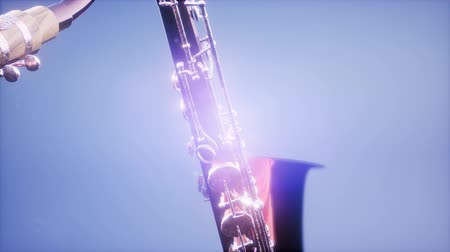 aro : Golden Tenor Saxophone on blue background with light Stock Footage