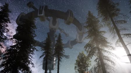 levitate : UFO hovering over a forest at night with light beam Stock Footage
