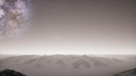 starry sky : aerial view of Milky Way above snow covered terrain Stock Footage