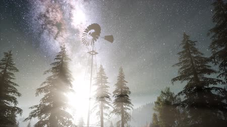 прерия : retro windmill in mountain forest with stars. hyperlapse
