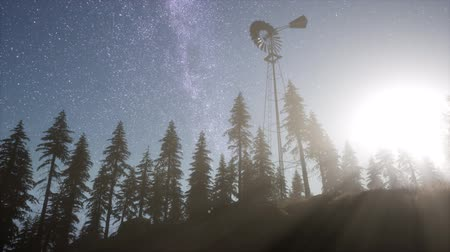 pompki : retro windmill in mountain forest with stars. hyperlapse