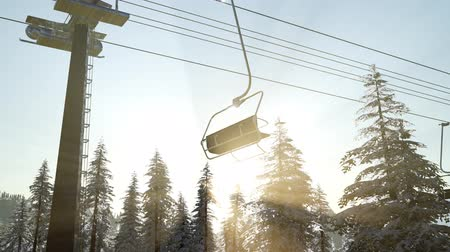 slovenya : empty ski lift. chairlift silhouette on high mountain over the forest at sunset
