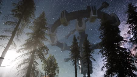 unidentified : UFO hovering over a forest at night with light beam Stock Footage