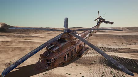 copter : old rusted military helicopter in the desert at sunset
