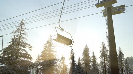 chair lift : empty ski lift. chairlift silhouette on high mountain over the forest at sunset