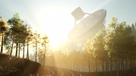 parabola antenna : The observatory radio telescope in forest at sunset Stock Footage
