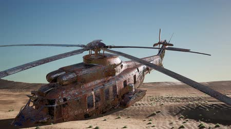 elpusztított : old rusted military helicopter in the desert at sunset
