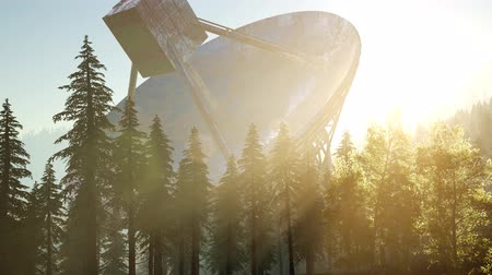 transmitting : The observatory radio telescope in forest at sunset Stock Footage
