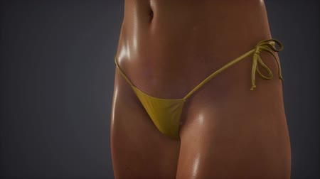 posando : Fashionable young woman in swimsuit posing in studio Stock Footage