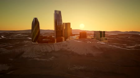 wschód słońca : city skyscrapes in desert at sunset