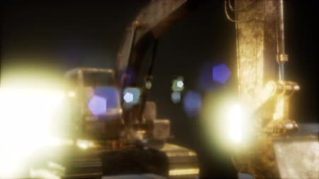 backhoe loader : excavator in the dark with bright lights
