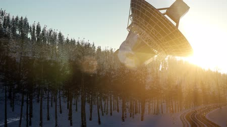 alıcı : The observatory radio telescope in forest at sunset Stok Video
