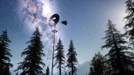 prairie : retro windmill in mountain forest with stars. hyperlapse