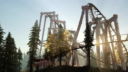 céu azul : old roller coaster at sunset in forest