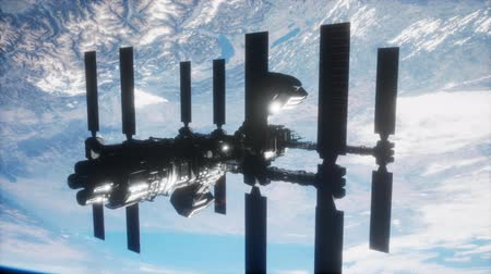 posição : International Space Station in outer space over the planet Earth Vídeos