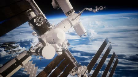 international space station : International Space Station in outer space over the planet Earth Stock Footage