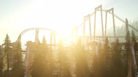 kolumny : old roller coaster at sunset in forest