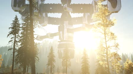 levitate : UFO hovering over a forest at sunset with light beam