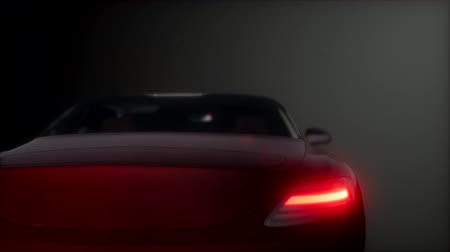 mobilitás : luxury sport car in dark studio with bright lights