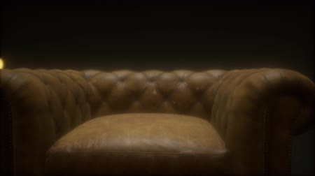 conveniente : vintage leather armchair boss Stock Footage