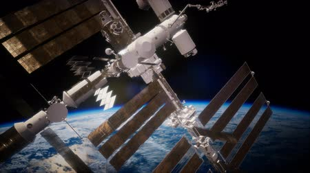 orbital : International Space Station in outer space over the planet Earth Stock Footage