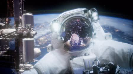 andromeda : Astronaut at spacewalk. Elements of this image furnished by NASA Stock Footage