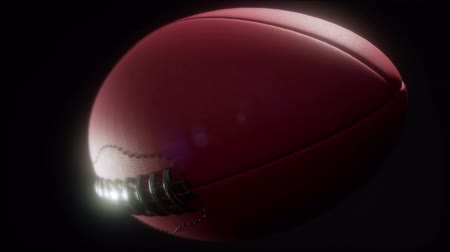 troféu : 4K Super slow motion flying football on black background