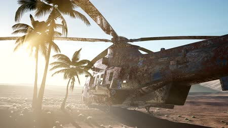 vrak : old rusted military helicopter in the desert at sunset