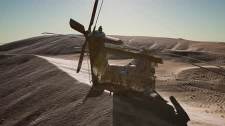 demolição : old rusted military helicopter in the desert at sunset
