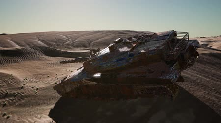 dune : Militairy tanks destructed in the desert at sunset