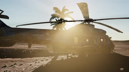 infantry : old rusted military helicopter in the desert at sunset